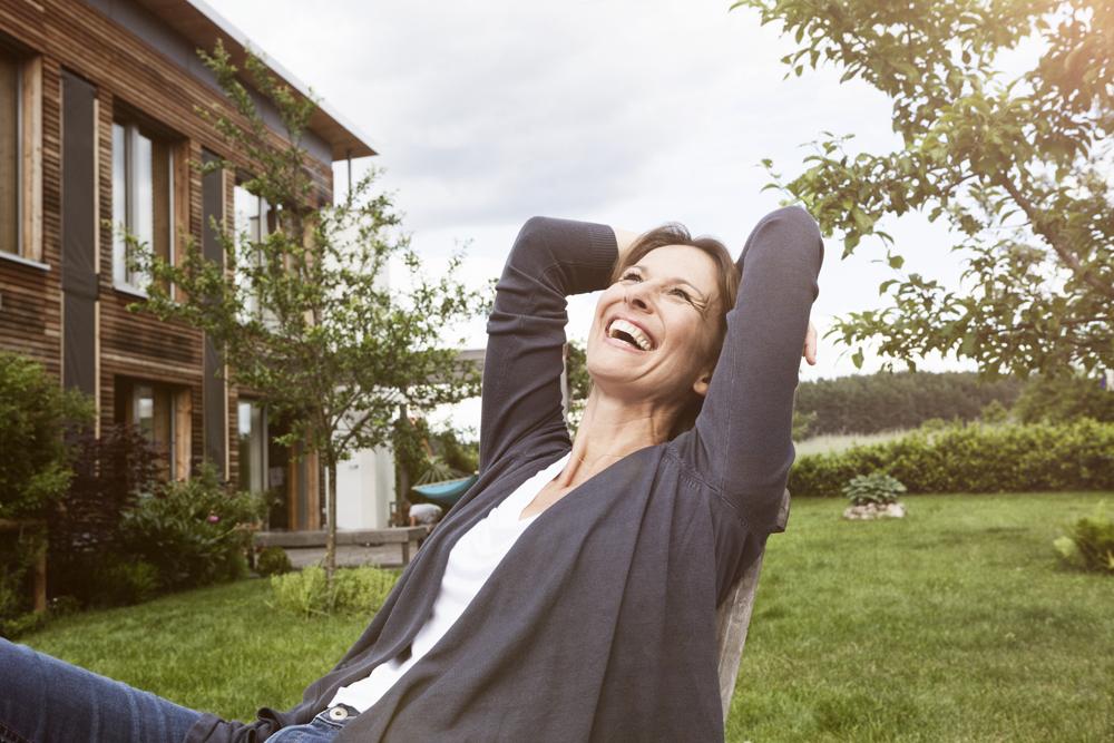 Laughing Woman Relaxing In Garden