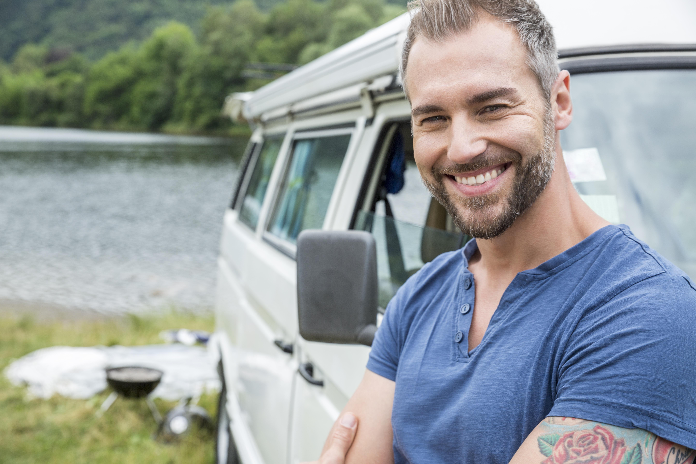 Portrait Of Smiling Man At Van At Lakeside